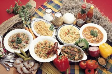 Large spread of creole cuisine, including crawfish