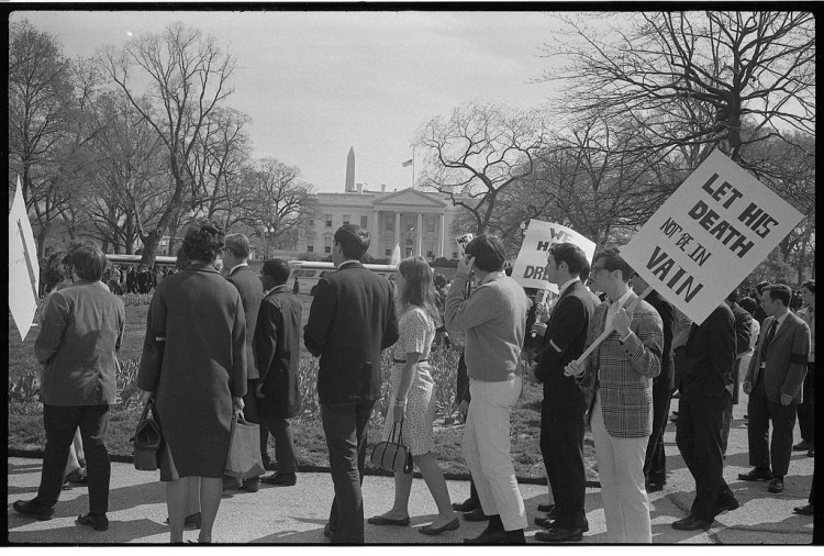"""Demonstrators with signs, one reading """"Let his death not be in vain"""", in front of the White House, after the assassination of Martin Luther King, April, 1968"""