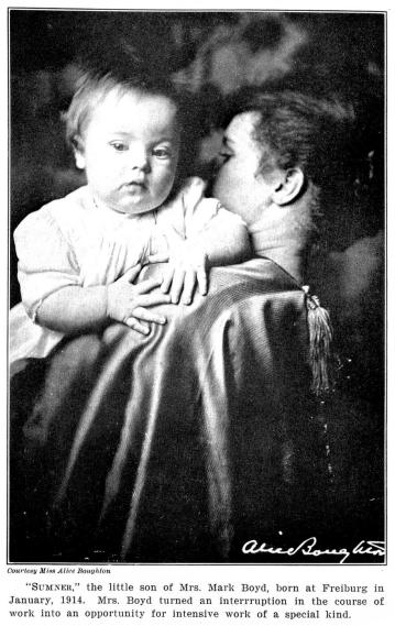 A black and white photograph of a white woman facing away from the camera, holding a chubby white baby  over her shoulder