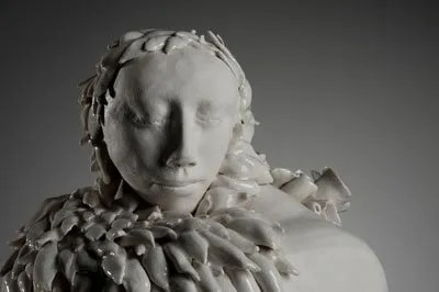 listening - a porcelain, partially Celedon glazed sculpture.
