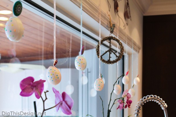 Easter decor with hanging decorative hollow eggs for window or fireplace mantle decor.