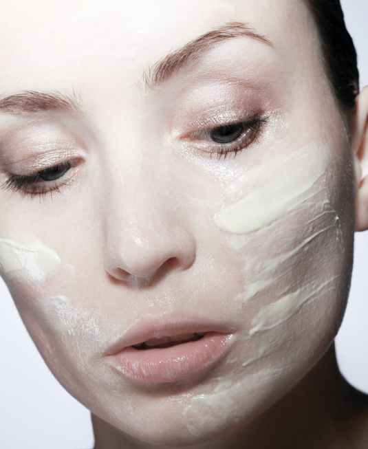 close up photo of woman with face cream