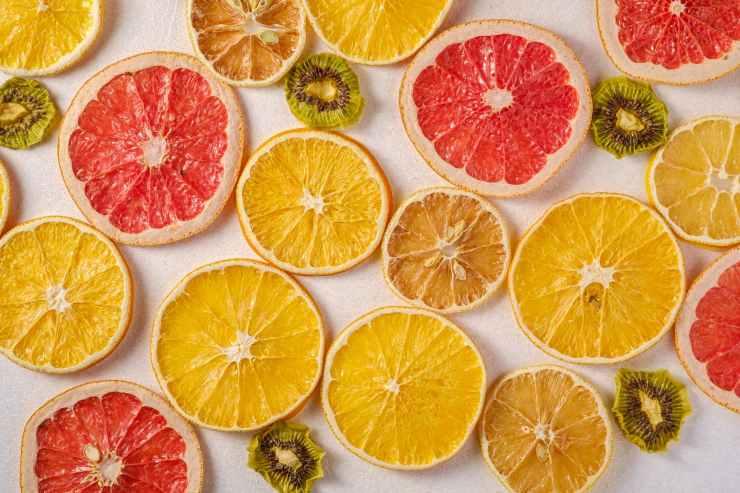 sliced oranges grapefruit and kiwi fruit