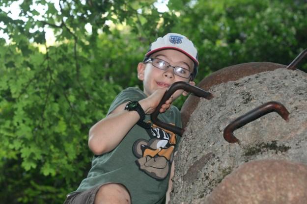 Me climbing a climbing stone