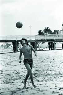Rod Stewart playing on the beach in Hollywood, Florida, before a concert by Rod Stewart and the Faces, April 1972.