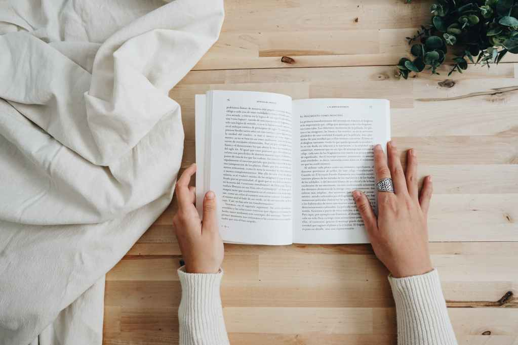 photo of person holding a book