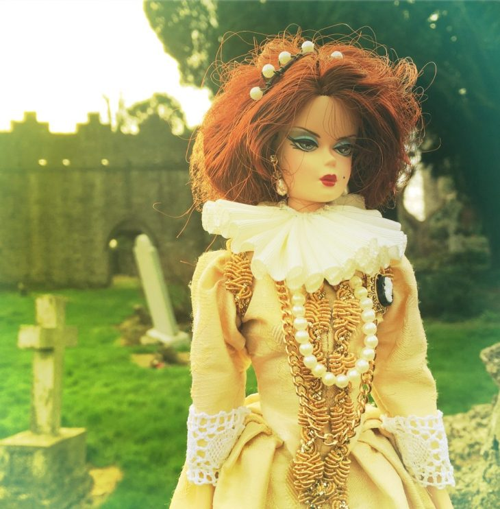 Silkstone Barbie in a Queen Elizabeth gold silk gown with gold trim and white ruff.