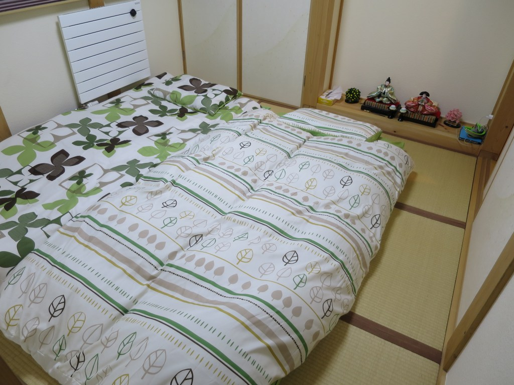 """Lucy and I are sleeping on a """"futon"""" (a traditional Japanese mattress) at Kyoka's house"""