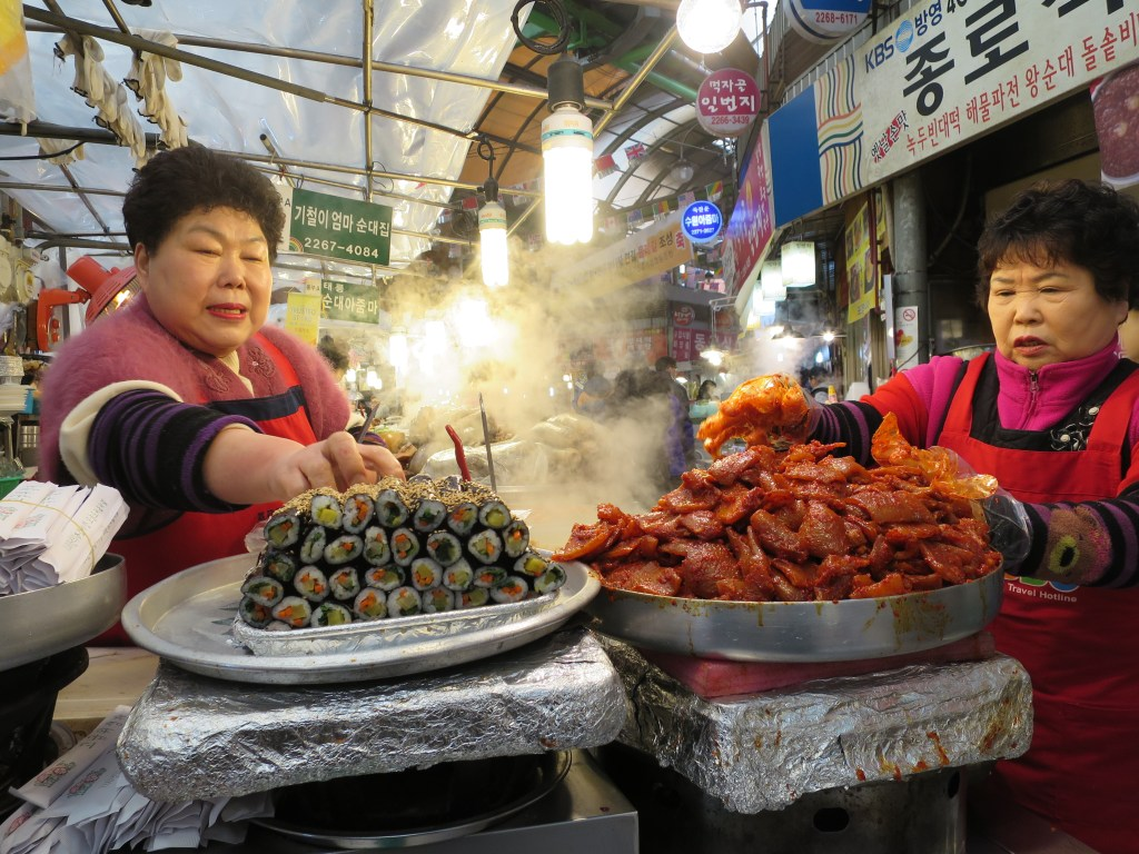 If I had to sum Seoul up in photograph, it would be this one: ajummas and street food