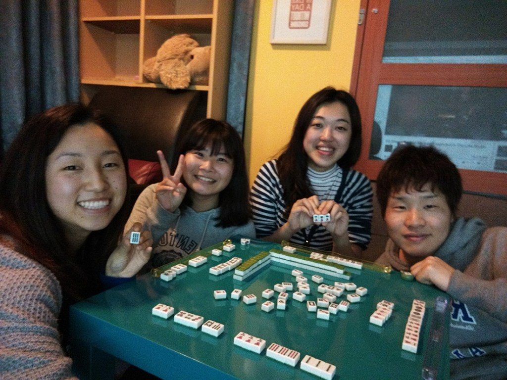 """I learned how to play Mahjong at the hostel. This is after my first """"hu"""" (win)! Go Dina!"""