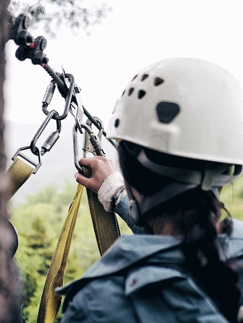 Ver learning how to zipline with Alpine Adventures