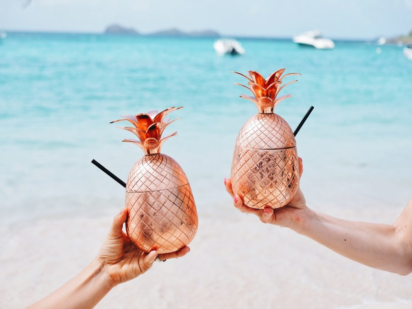 Cocktails in copper pineapples at Nikki Beach St. Barth