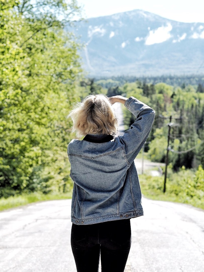 Jeanne Rondeau Ducharme taking a picture along the highway in New Hampshire