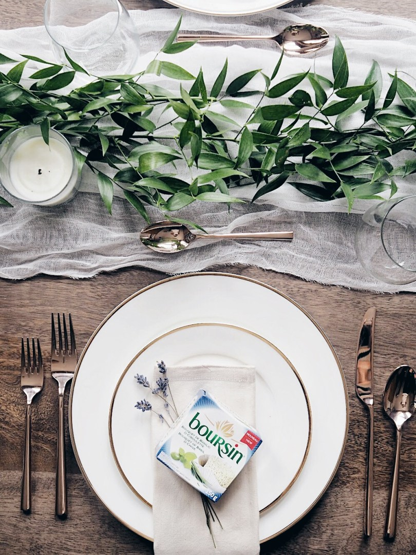 Beautiful table setting with Boursin cheese on the plate