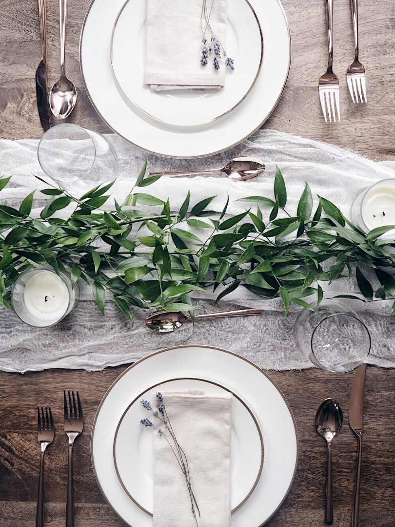 Tablescape created at home with italian ruscus and rose gold flatware