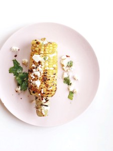 Mexican street corn with cotija cheese and Mexican crema