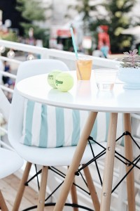 Eames chairs, white tables, tennis and cocktails