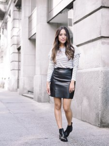Me wearing leather skirt and ankle boots