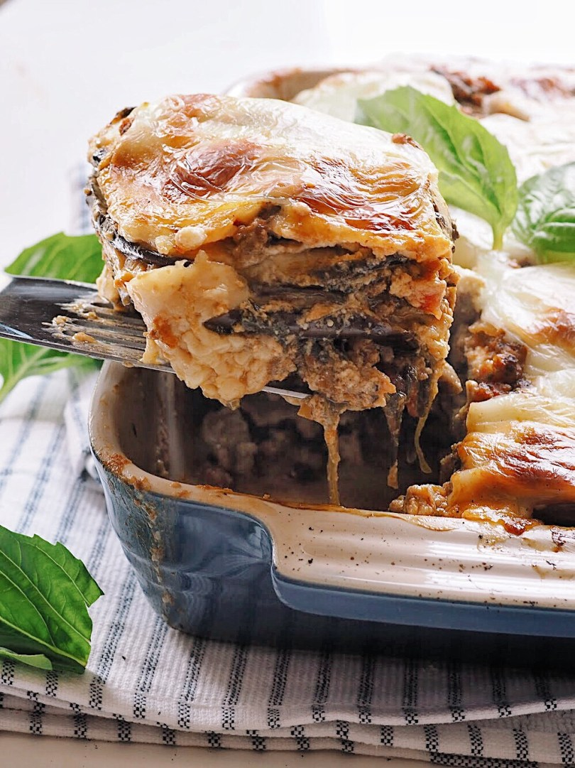 Scooping lasagna out of baking dish