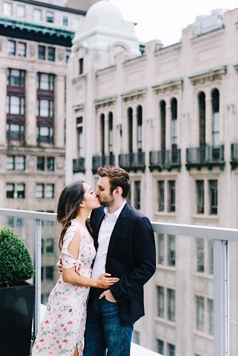 Kissing on the rooftop terrace at One King West