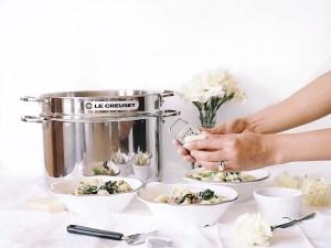 Grating grana padano over top of dish
