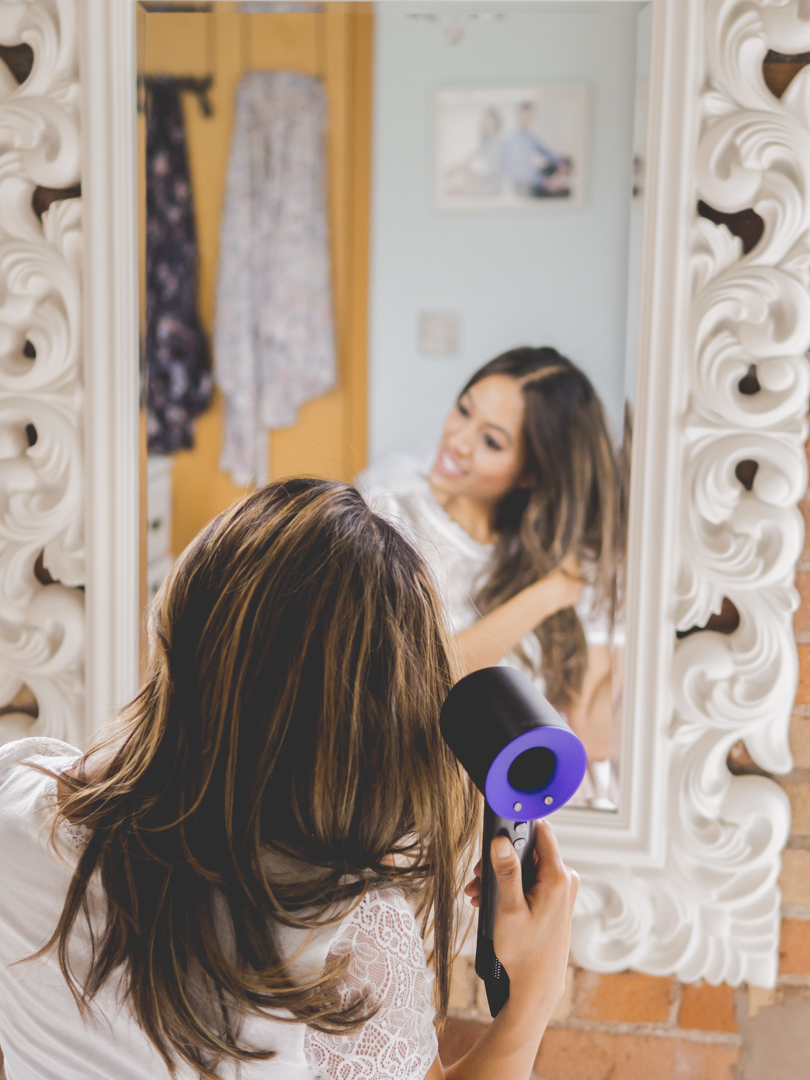 Shot from behind the mirror using Dyson Supersonic for healthy hair