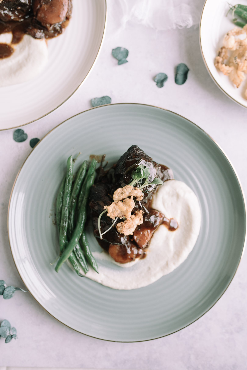 Braised beef with celery root puree, haricot verts and fried cipollini onions