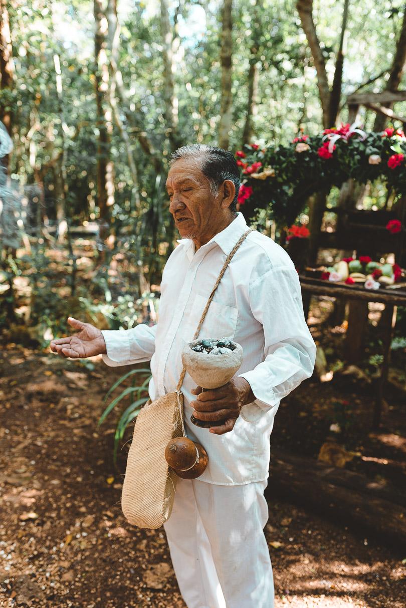 Mayan Shaman giving us a blessing before entering Cenote Maya