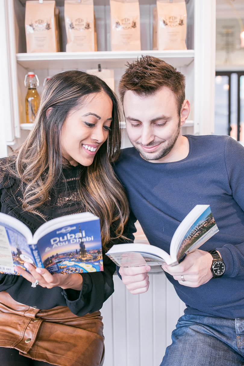 Reading our travel guidebooks to plan our honeymoon