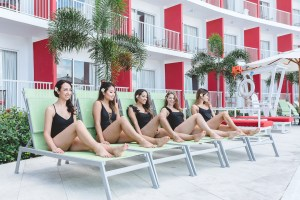 Picture of all the girls sitting on lounge chairs at Royal Decameron Cornwall Beach