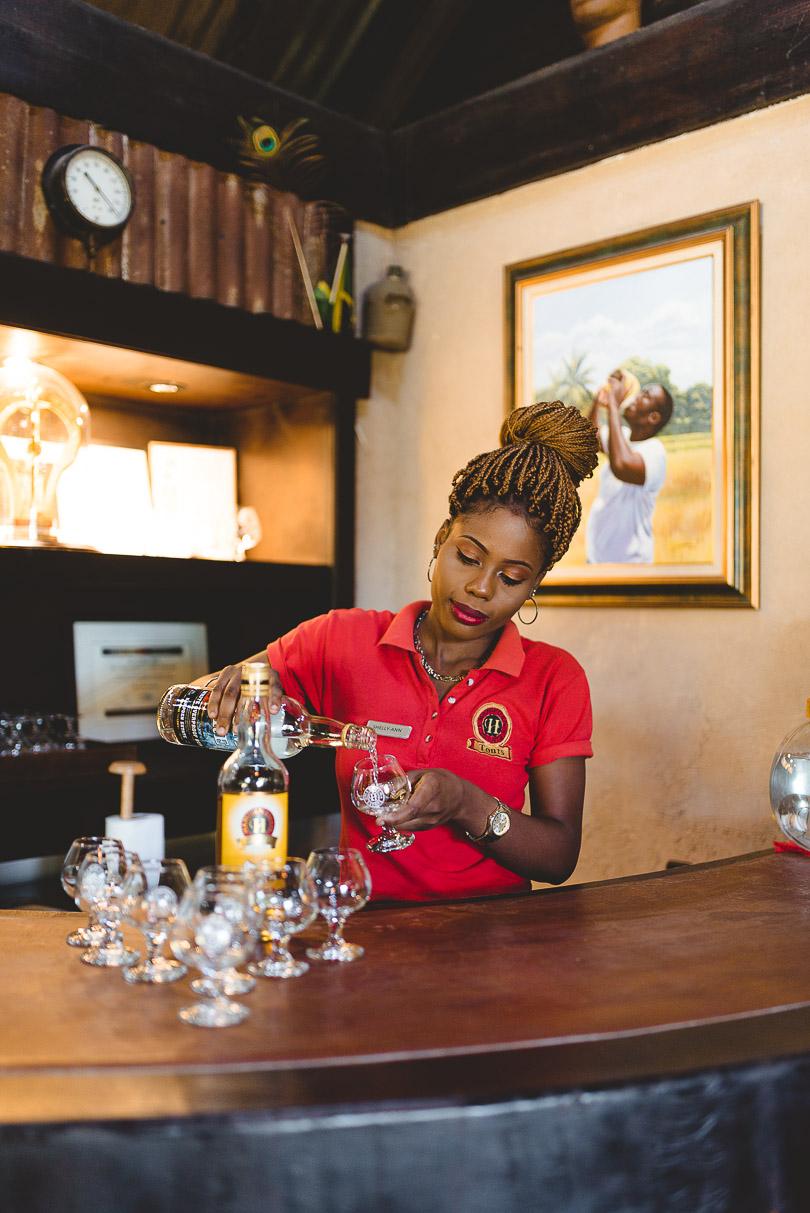 Woman pouring rum at Hampden Estate Rum Tour