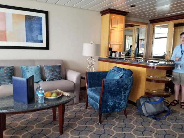 The couch and bar area in Grand Suite 1298 on the Royal Caribbean Liberty of the Seas.