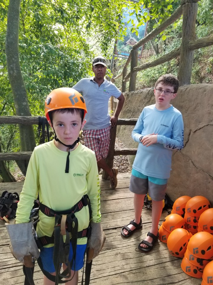 Gumbalimba Park with one child who wanted to zipline, Rony, and the child who declined to zipline. The child who declined made the better choice, which I will cover in a different post.