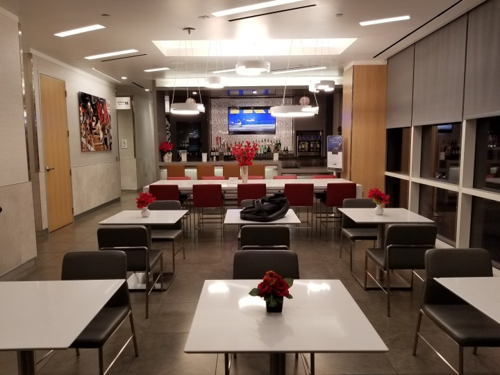 Bar and seating area in the IAH Admiral's Club in Terminal A.