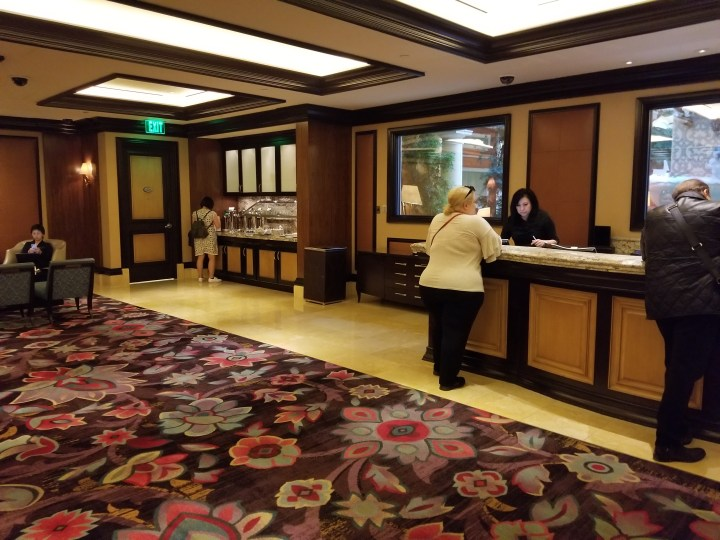 Check in desk and refreshment center at the Bellagio Chairman's Lounge.