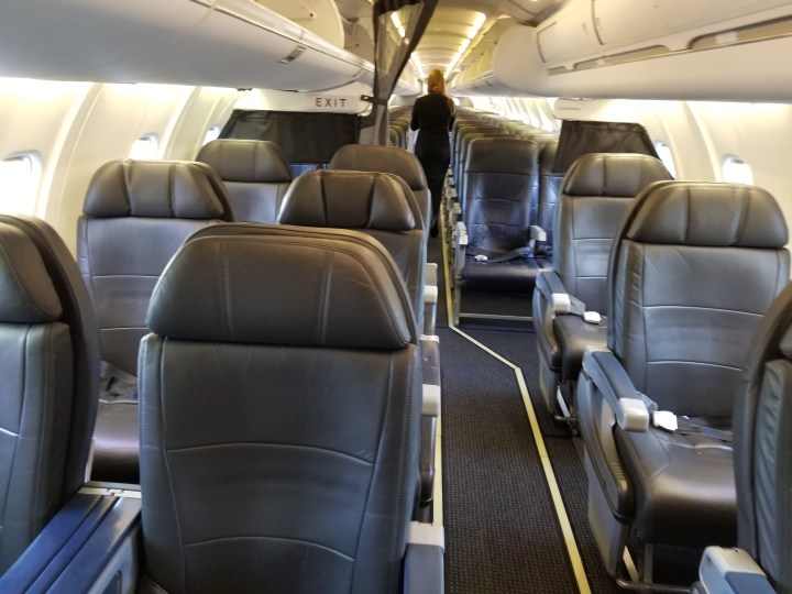 The first class cabin on an American Airlines regional jet. Specifically, this is a CRJ-900.