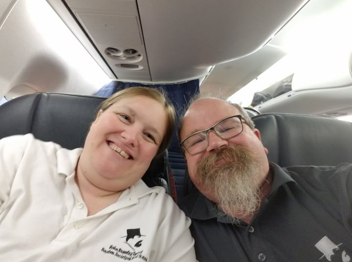 Mr. and Mrs. John Brawley Tophat in United first class on their flight to San Juan.
