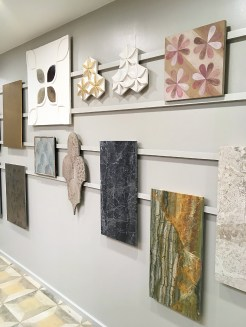 Tile samples displayed on the wall.