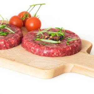 Raw beef hambuger isolated on white background
