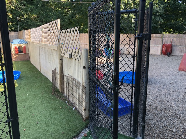 Photo of the two halves of Dingo's outdoor play area.