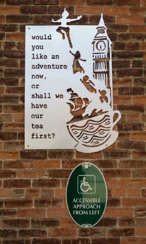 metal sign by local artist at Curiosi-Tea