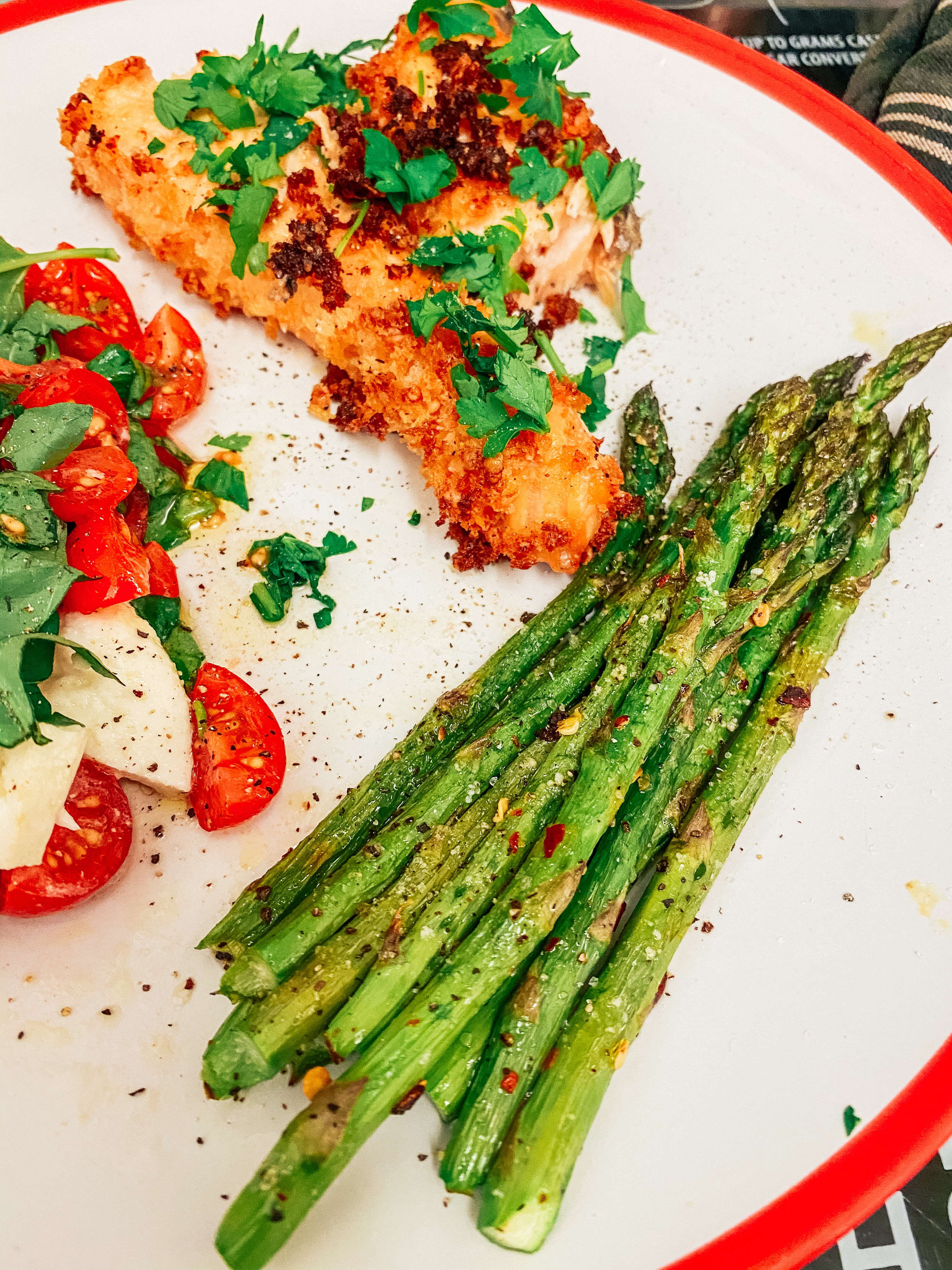 Emmental and herb crusted salmon with asparagus and caprese salad
