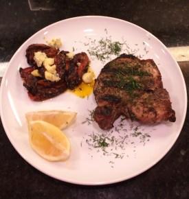 Porchetta-style chops, roasted tomatoes, fresh lemon