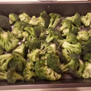 broccoli ready for the oven, then added to pan-seared pork