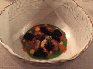 Lobster, raw langoustine, squid ink croutons, broccoli cream and orange sauce