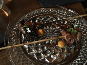 Firefly squid yakitori grilled over oak and marinated with persimmon and yuzu kosho