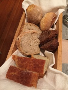 bread assortment: white rolls, rosemary, pine nut and goat cheese