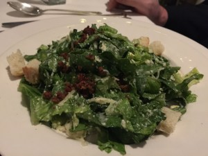 Commander's Crisp Romaine Salad: hearts of romaine, grated Parmesan, pressed egg, housemade bacon, French bread croutons, shave Gruyere and black pepper dressing