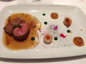 Lamb with different flavors and textures accompanied with fried grapes and longan