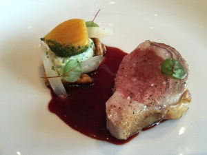 Rib-eye of Elysian Fields Farm's lamb with melted Savoy Cabbage, glazed Salsify root, yellow beets, English walnuts and